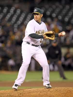 OAKLAND, CA - AUGUST 16:  Brian Fuentes #57 of the Oakland Athletics pitches against the Baltimore Orioles at O.co Coliseum on August 16, 2011 in Oakland, California.  (Photo by Ezra Shaw/Getty Images)