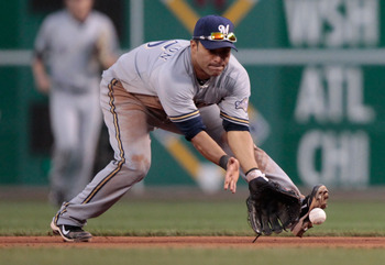 PITTSBURGH - AUGUST 22:  Jerry Hairston #15 of the Milwaukee Brewers fields a ground ball against the Pittsburgh Pirates during the game on August 22, 2011 at PNC Park in Pittsburgh, Pennsylvania.  (Photo by Jared Wickerham/Getty Images)