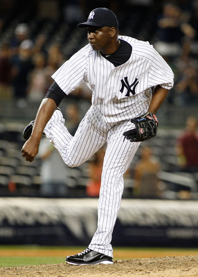 NEW YORK, NY - JULY 30:  Rafael Soriano #29 of the New York Yankees delivers a pitch against the Baltimore Orioles in the ninth inning on July 30, 2011 at Yankee Stadium in the Bronx borough of New York City. Yankees defeated the Orioles 17-3.  (Photo by