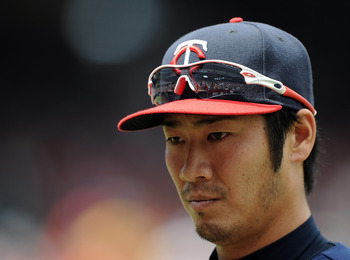 ANAHEIM, CA - SEPTEMBER 04:  Tsuyoshi Nishioka #1 of the Minnesota Twins leaves the field during the game against the Los Angeles Angels of Anaheim at Angel Stadium of Anaheim on September 4, 2011 in Anaheim, California.  (Photo by Harry How/Getty Images)