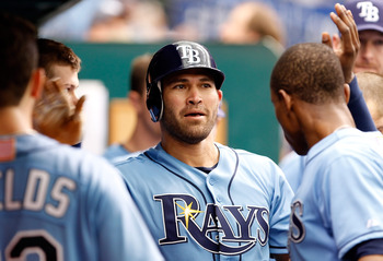 ST PETERSBURG, FL - SEPTEMBER 11:  Designated hitter Johnny Damon #22 of the Tampa Bay Rays is congratulated after scoring against the Boston Red Sox during the game at Tropicana Field on September 11, 2011 in St. Petersburg, Florida.  (Photo by J. Meric/