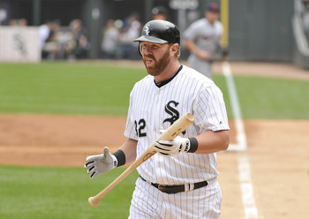 CHICAGO, IL - SEPTEMBER 10:  Adam Dunn #32 of the Chicago White Sox walks back to the dugout after striking out during the first inning against the Cleveland Indians at U.S. Cellular Field on September 10, 2011 in Chicago, Illinois.  (Photo by Brian Kerse