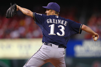 ST. LOUIS, MO -SEPTEMBER 7: Starter Zack Greinke #13 of the Milwaukee Brewers pitches against the St. Louis Cardinals at Busch Stadium on September 7, 2011 in St. Louis, Missouri.  (Photo by Dilip Vishwanat/Getty Images)