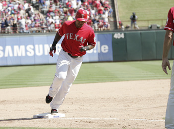 ARLINGTON, TX - SEPTEMBER 11: Adrian Beltre #29 of the Texas Rangers rounds third base on his 300th career home run hit against the Oakland Athletics at Rangers Ballpark in Arlington on September 11, 2011 in Arlington, Texas. (Photo by Rick Yeatts/Getty I