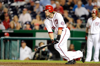 WASHINGTON, DC - SEPTEMBER 09:  Jayson Werth #28 of the Washington Nationals hits a single that leads to the game winning run on an error in the eleventh inning against the Houston Astros at Nationals Park on September 9, 2011 in Washington, DC. Washingto