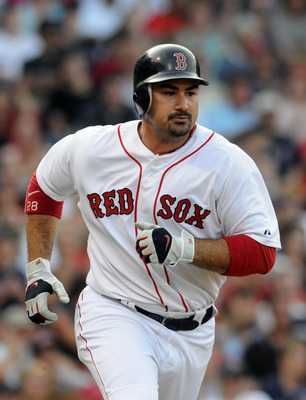 BOSTON, MA - SEPTEMBER 03: Adrian Gonzalez #28 of the Boston Red Sox runs to first base in the third inning against the Texas Rangers at Fenway Park on September 3, 2011 in Boston, Massachusetts. The Boston Red Sox won the game 12-7. (Photo by Darren McCo