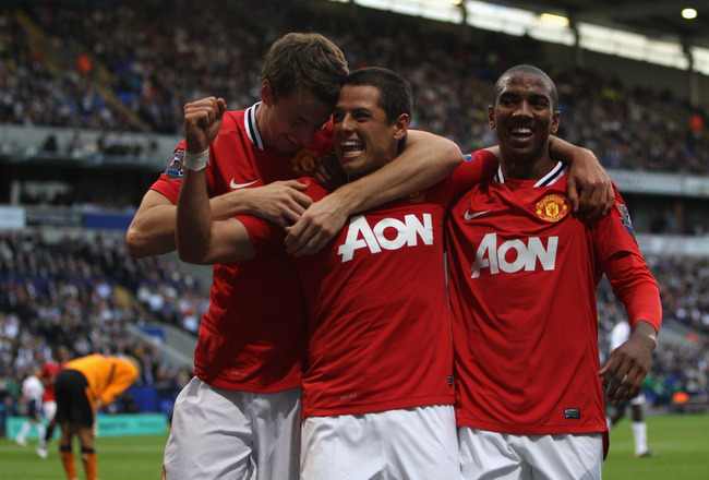 BOLTON, ENGLAND - SEPTEMBER 10:  Javier Hernandez (C) of Manchester United celebrates scoring the fourth goal with Ashley Young (R) and Johnny Evans (L)  during the Barclays Premier League at the Reebok Stadium on September 10, 2011 in Bolton, England.  (