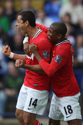 BOLTON, ENGLAND - SEPTEMBER 10:  Javier Hernandez (L) of Manchester United celebrates after scoring the opening goal with Ashley Young (R) during the Barclays Premier League at the Reebok Stadium on September 10, 2011 in Bolton, England.  (Photo by Michae