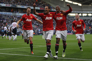 BOLTON, ENGLAND - SEPTEMBER 10: Javier Hernandez (C) of Manchester United celebrates scoring the fourth goal with Ashley Young (R) and Johnny Evans (L)  during the Barclays Premier League at the Reebok Stadium on September 10, 2011 in Bolton, England.  (P