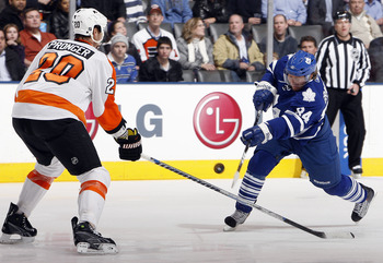 TORONTO, CANADA - DECEMBER 9: Mikhail Grabovski #84 of the Toronto Maple Leafs shoots into the feet of Chris Pronger #20 of the Philadelphia Flyers during game action at the Air Canada Centre December 9, 2010 in Toronto, Ontario, Canada. (Photo by Abelima