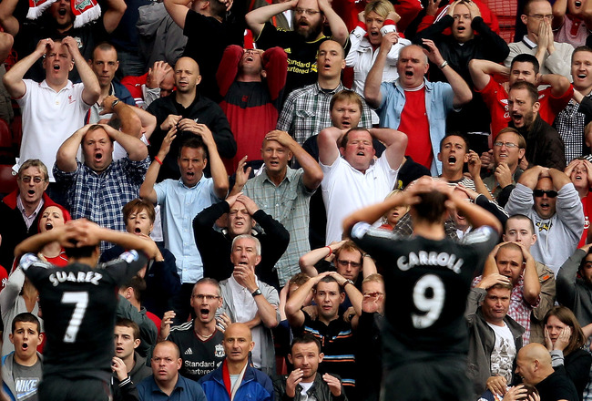 STOKE ON TRENT, ENGLAND - SEPTEMBER 10:   Liverpool fans look dejected during the Barclays Premier League match between Stoke City and Liverpool at Britannia Stadium on September 10, 2011 in Stoke on Trent, England.  (Photo by Scott Heavey/Getty Images)
