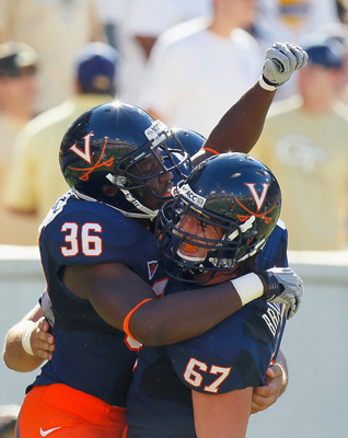 ATLANTA - OCTOBER 09:  Max Milien #36  of the Virginia Cavaliers celebrates his touchdown against the Georgia Tech Yellow Jackets with Landon Bradley #67 at Bobby Dodd Stadium on October 9, 2010 in Atlanta, Georgia.  (Photo by Kevin C. Cox/Getty Images)