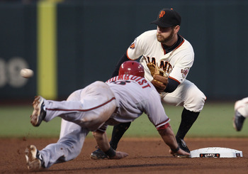 SAN FRANCISCO, CA - SEPTEMBER 03: Jeff Keppinger #8 of the San Francisco Giants tags out Willie Bloomquist #18 of the Arizona Diamondbacks on a steal attempt at AT&T Park on September 3, 2011 in San Francisco, California.  (Photo by Tony Medina/Getty Imag