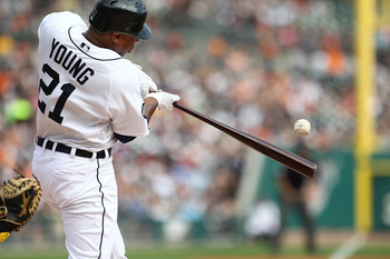 DETROIT, MI - SEPTEMBER 10:  Delmon Young #21 of the Detroit Tigers hits the baseball against the Minnesota Twins during a MLB game at Comerica Park on September 10, 2011 in Detroit, Michigan.  (Photo by Dave Reginek/Getty Images)