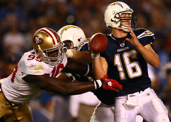 SAN DIEGO, CA - SEPTEMBER 1:   Quarterback Scott Tolzien #16 of the San Diego Chargers throws with pressure against the San Francisco 49ers during their preseason NFL Game on September 1, 2011 at Qualcomm Stadium in San DIego, California. (Photo by Donald