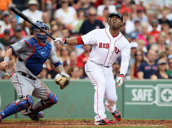 BOSTON, MA - SEPTEMBER 04:  Carl Crawford #13 of the Boston Red Sox reacts after striking out in the second inning as Mike Napoli #25 of the Texas Rangers catches on September 4, 2011 at Fenway Park in Boston, Massachusetts.  (Photo by Elsa/Getty Images)