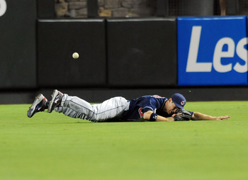 PHOENIX, AZ - JUNE 27:  Grady Sizemore #24 of the Cleveland Indians dives and misses a line drive that rolls to the fence against the Arizona Diamondbacks at Chase Field on June 27, 2011 in Phoenix, Arizona.  (Photo by Norm Hall/Getty Images)