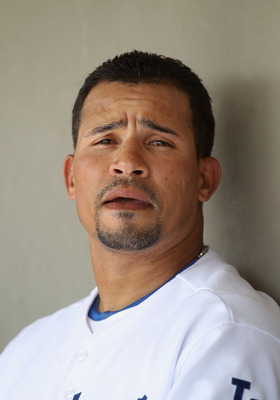 GLENDALE, AZ - MARCH 05:  Rafael Furcal #15 of the Los Angeles Dodgers watches from the dugout during the spring training game against the Cincinnati Reds at Camelback Ranch on March 5, 2011 in Glendale, Arizona.  (Photo by Christian Petersen/Getty Images