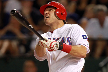 ARLINGTON, TX - AUGUST 10:  Ian Kinsler #5 of the Texas Rangers hits a two-run home run against the Seattle Mariners at Rangers Ballpark in Arlington on August 10, 2011 in Arlington, Texas.  (Photo by Ronald Martinez/Getty Images)
