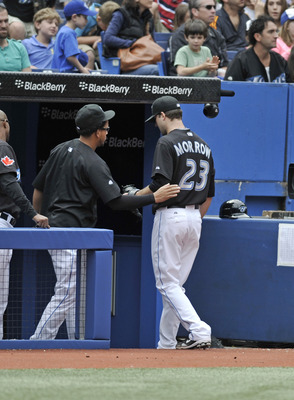 TORONTO, CANADA - AUGUST 28:  Henderson Alvarez #37 of the Toronto Blue Jays meets teammate Brandon Morrow #23 as he walks off the field during MLB game action the Tampa Bay Rays August 28, 2011 at Rogers Centre in Toronto, Ontario, Canada. (Photo by Brad