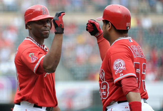 ANAHEIM, CA - SEPTEMBER 04:  Bobby Abreu #53 of the Los Angeles Angels of Anaheim celebrates his solo homerun with teammate Torii Hunter #48 for a 1-0 lead over the Minnesota Twins during the first inning at Angel Stadium of Anaheim on September 4, 2011 i