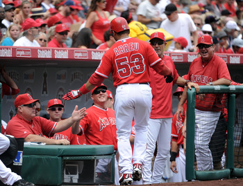 ANAHEIM, CA - SEPTEMBER 04:  Bobby Abreu #53 of the Los Angeles Angels of Anaheim celebrates his solo homerun with Manager manager Mike Scioscia and the dugout for a 1-0 lead over the Minnesota Twins during the first inning at Angel Stadium of Anaheim on