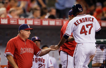 ANAHEIM, CA - SEPTEMBER 02:  Howie Kendrick #47 of the Los Angeles Angels of Anaheim is congratulated by manager Mike Scioscia (L) after scoring a run against the Minnesota Twins in the first inning at Angel Stadium of Anaheim on September 2, 2011 in Anah