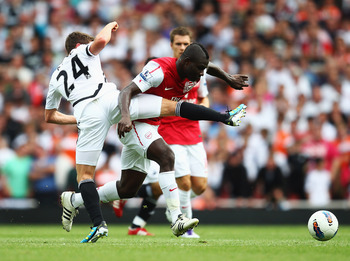 LONDON, ENGLAND - SEPTEMBER 10:  Emmanuel Frimpong of Arsenal battles with Joe Allen of Swansea City during the Barclays Premier League match between Arsenal and Swansea City at Emirates Stadium on September 10, 2011 in London, England.  (Photo by Clive M