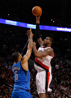 PORTLAND, OR - APRIL 21:  LaMarcus Aldridge #12 of the Portland Trail Blazers shoots against Tyson Chandler #6 of the Dallas Mavericks in Game Three of the Western Conference Quarterfinals in the 2011 NBA Playoffs on April 21, 2011 at the Rose Garden in P