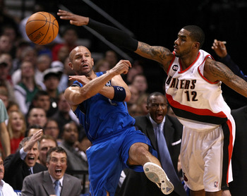 PORTLAND, OR - APRIL 23:  LaMarcus Aldridge #12 of the Portland Trail Blazers defends Jason Kidd #2 of the Dallas Mavericks in Game Four of the Western Conference Quarterfinals in the 2011 NBA Playoffs on April 23, 2011 at the Rose Garden in Portland, Ore
