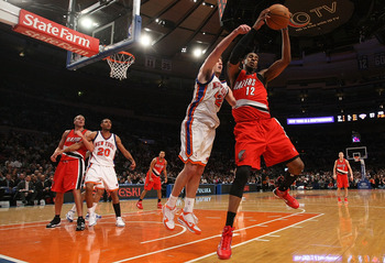 NEW YORK - DECEMBER 07:  LaMarcus Aldridge #12 of the Portland Trail Blazers rebounds against David Lee #42 of the New York Knicks at Madison Square Garden on December 7, 2009 in New York, New York. NOTE TO USER: User expressly acknowledges and agrees tha