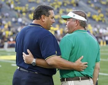 ANN ARBOR, MI - SEPTEMBER 10: University of Michigan head coach Brady Hoke and Notre Dame head coach Brian Kelly meet on the field prior to the start of the game at Michigan Stadium on September 10, 2011 in Ann Arbor, Michigan.  (Photo by Leon Halip/Getty