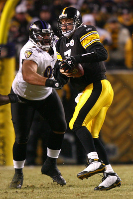 PITTSBURGH - JANUARY 18:  Ben Roethlisberger #7 of the Pittsburgh Steelers is pressured by Haloti Ngata #92 of the Baltimore Ravens during the AFC Championship game on January 18, 2009 at Heinz Field in Pittsburgh, Pennsylvania.  (Photo by Al Bello/Getty