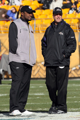 PITTSBURGH - DECEMBER 27:  Head coach John Harbaugh (R) of the Baltimore Ravens and head coach Mike Tomlin of the Pittsburgh Steelers meet at midfield before the game at Heinz Field on December 27, 2009 in Pittsburgh, Pennsylvania.  (Photo by Karl Walter/