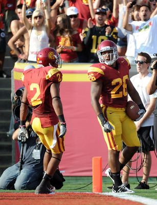 LOS ANGELES, CA - SEPTEMBER 10:  Marc Tyler #26 of the USC Trojans reacts to his touchdown with Robert Woods #2 for a 7-0 lead over the Utah Utes during the first quarter at Los Angeles Memorial Coliseum on September 10, 2011 in Los Angeles, California.