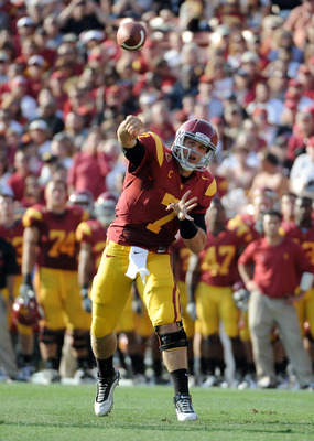 LOS ANGELES, CA - SEPTEMBER 10:  Matt Barkley #7 of the USC Trojans makes a pass against the Utah Utes during the first quarter at Los Angeles Memorial Coliseum on September 10, 2011 in Los Angeles, California.  (Photo by Harry How/Getty Images)