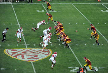 LOS ANGELES, CA - SEPTEMBER 10:  Matt Barkley #7 of the USC Trojans takes a snap against the Utah Utes in front of a new Pac 12 logo during the third quarter at Los Angeles Memorial Coliseum on September 10, 2011 in Los Angeles, California.  (Photo by Har