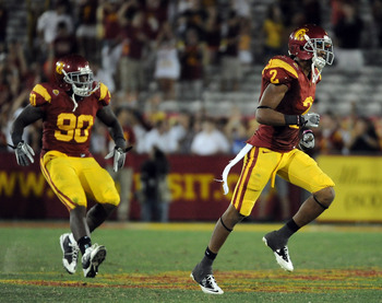 LOS ANGELES, CA - SEPTEMBER 10:  Robert Woods #2 of the USC Trojans reacts with George Uko #90 after a 17-14 win against the Utah Utes at Los Angeles Memorial Coliseum on September 10, 2011 in Los Angeles, California.  (Photo by Harry How/Getty Images)