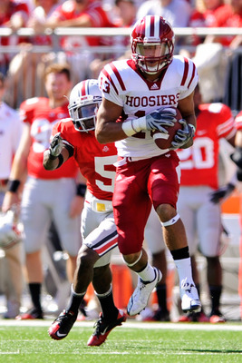 COLUMBUS, OH - OCTOBER 9:  Kofi Hughes #13 of the Indiana Hoosiers makes a pass reception in front of Chimdi Chekwa #5 of the Ohio State Buckeyes at Ohio Stadium on October 9, 2010 in Columbus, Ohio.  (Photo by Jamie Sabau/Getty Images)