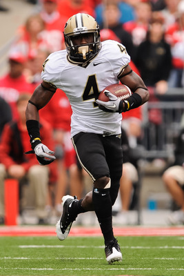 COLUMBUS, OH - OCTOBER 23:  O.J. Ross #4 of the Purdue Boilermakers runs with the ball against the Ohio State Buckeyes at Ohio Stadium on October 23, 2010 in Columbus, Ohio.  (Photo by Jamie Sabau/Getty Images)