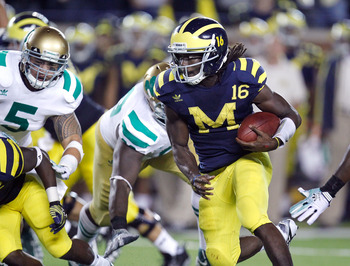 ANN ARBOR, MI - SEPTEMBER 10: Denard Robinson #16 of the Michigan Wolverines scores a forth quarter touchdown while playing the Notre Dame Fighting Irish at Michigan Stadium on September 10, 2010 in Ann Arbor, Michigan. Michigan won the game 35-31.(Photo