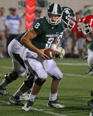 EAST LANSING, MI - SEPTEMBER 02:  Kirk Cousins #8 of the Michigan State Spartans looks to hand off the ball during an NCAA football game against the Youngstown State Penguins at Spartan Stadium on September 2, 2011 in East Lansing, Michigan. The Spartans