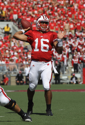 MADISON, WI - SEPTEMBER 10:  Russell Wilson #16 of the Wisconsin Badgers throws a touchdown pass against the Oregon State Beavers at Camp Randall Stadium on September 10, 2011 in Madison Wisconsin. Wisconsin defeated Oregon State 35-0.  (Photo by Jonathan