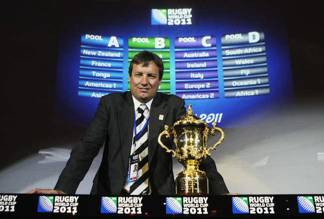 LONDON - DECEMBER 01:  Martin Snedden, CEO of Rugby New Zealand 2011 poses with the William Webb Ellis Trophy following the IRB Rugby World Cup 2011 Pool Allocation Draw at Tower Bridge on December 1, 2008 in London, England.  (Photo by David Rogers/Getty