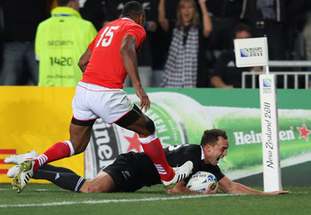 AUCKLAND, NEW ZEALAND - SEPTEMBER 09: Israel Dagg of the All Blacks scores a try during the IRB 2011 Rugby World Cup Pool A match between New Zealand and Tonga at Eden Park on September 9, 2011 in Auckland, New Zealand.  (Photo by Sandra Mu/Getty Images)
