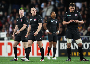 DUNEDIN, NEW ZEALAND - SEPTEMBER 10: Mike Tindall (2ndL) of England looks on with team mates during the IRB 2011 Rugby World Cup Pool B match between Argentina and England at Otago Stadium on September 10, 2011 in Dunedin, New Zealand.  (Photo by David Ro