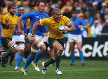 AUCKLAND, NEW ZEALAND - SEPTEMBER 11:  Digby Ioane of the Wallabies makes a run the IRB 2011 Rugby World Cup Pool C match between Australia and Italy at North Harbour Stadium on September 11, 2011 in Auckland, New Zealand.  (Photo by Mark Kolbe/Getty Imag