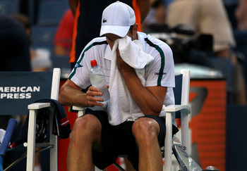 NEW YORK, NY - SEPTEMBER 09:  Andy Roddick of the United States wipes his face during a break in play against Rafael Nadal of Spain during Day Twelve of the 2011 US Open at the USTA Billie Jean King National Tennis Center on September 9, 2011 in the Flush
