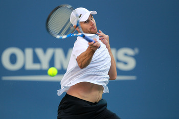 NEW YORK, NY - SEPTEMBER 09:  Andy Roddick of the United States returns a shot against Rafael Nadal of Spain during Day Twelve of the 2011 US Open at the USTA Billie Jean King National Tennis Center on September 9, 2011 in the Flushing neighborhood of the