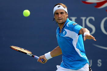 NEW YORK, NY - SEPTEMBER 08:  David Ferrer of Spain returns a shot against Andy Roddick of the United States on court 13 during Day Eleven of the 2011 US Open at the USTA Billie Jean King National Tennis Center on September 8, 2011 in the Flushing neighbo